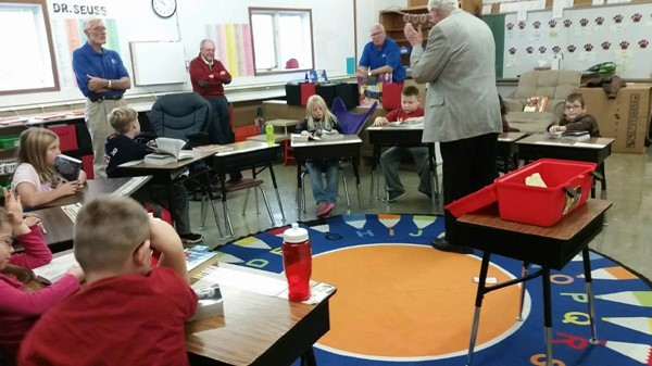Kiwanis handing out dictionary to 3rd graders!