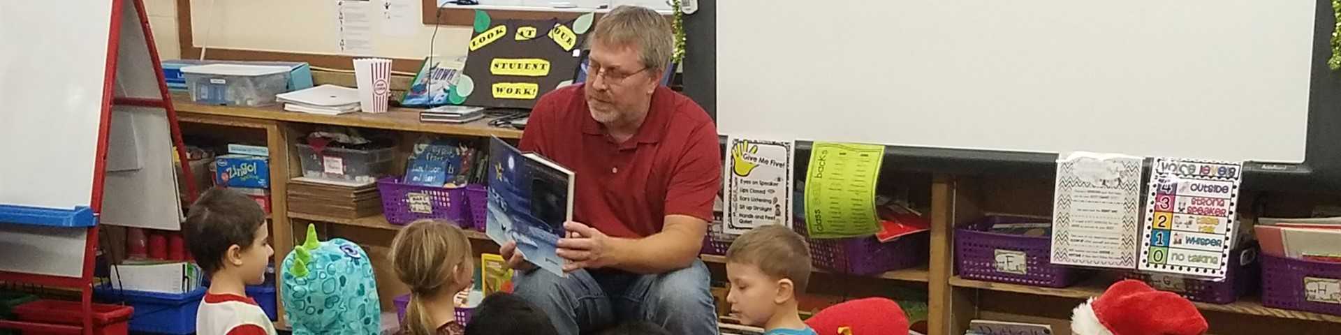 "Mr. Hueser Reading ""  The Night Before Christmas ""  to the First Graders"